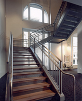 The grand stair case connects the second floor office space to the third floor board rooms. It consists of steel frame with stainless steel handrail and wood steps.