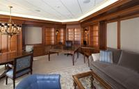 High end executive office with all custom cabinetry & surfaces.