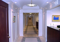 This corridor has wood columns and box beams approximately every 25 ft.
