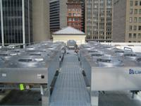 HVAC rooftop units, exterior brick patching and covers for HVAC piping.