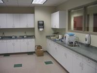This dental lab includes plastic laminate cabinets & countertops.  There is a viewing window from the hall corridor. A plaster trap basin in installed below the sink to protect the drains when plaster mouth casts are made and cleaned.