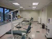 This dental lab includes reclining chairs with exam lights. This dental lab includes plastic laminate cabinets & countertops with goose neck faucets on sinks.