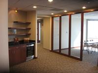 This view of the reception area shows a conference room with full height glass window lites including mahogany wood jambs and casing.